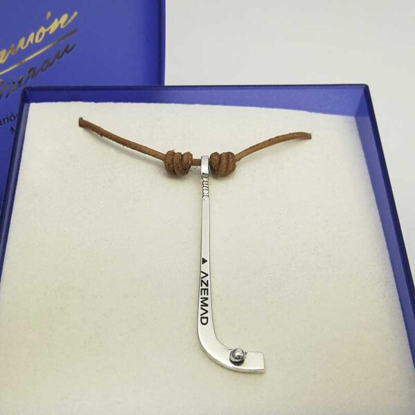 palo-hockey- stick-grabado